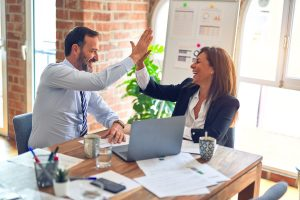 Business Leadership: Leader and Employee High Fiving