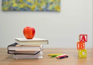 Good Business Environment: Teacher's Desk with books, apple and blocks